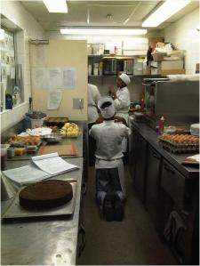 Tshabang on his knees in the pastry kitchen